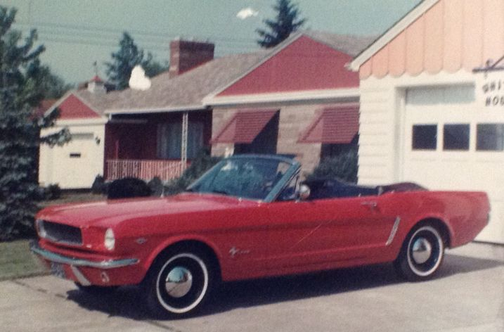 My dad's beloved 1964 1/2 red convertible.